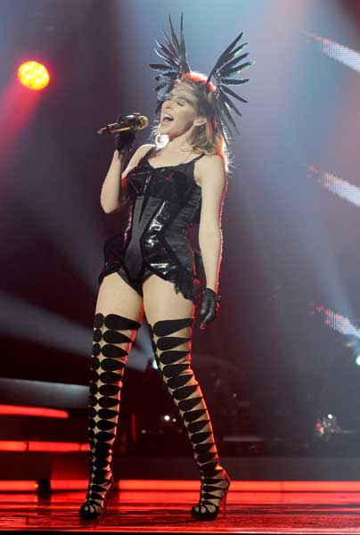 kylie minogue in thigh high christian louboutin boots