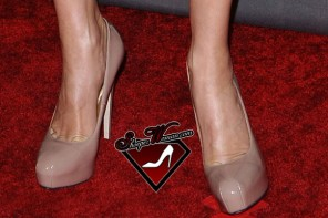 c422ea14e70 Celebrity Shoes  Lindsay Lohan in knee-high flat gladiator cut-out ...