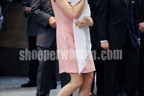 Victoria Beckham in a pink shift dress and nude Christian Louboutin heels carrying Harper Seven