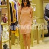 Victoria Beckham in pink mini dress and high heeled shoes