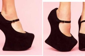 Black platform wedge shoes by Jeffrey Campbell