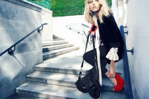 Model wearing Carvela red suede 'Grass' wedges and black trousers