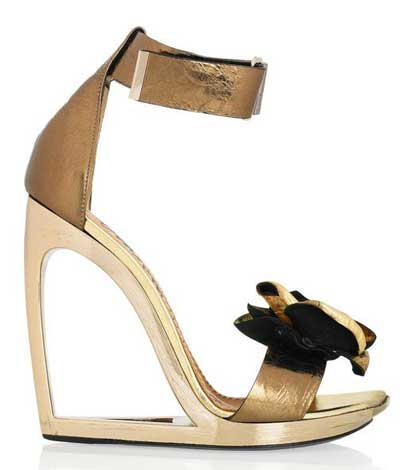 Gold wedge sandals with cutout heel and flower detail