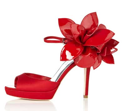 Red shoes with orchid on heel by Karen Millen