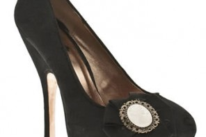 Black platform court shoes with cameo brooch