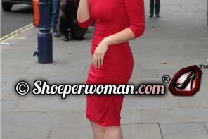 America Ferrera in a red dress and shoes