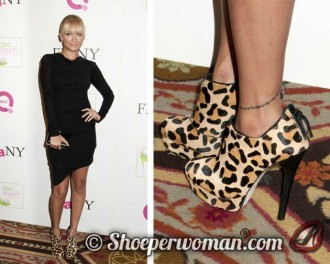 Nicole Richie in a black dress and leopard print ankle boots