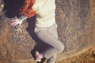 Shoeperwoman in gold Rocket Dog heels