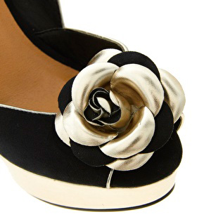 flower on toe of shoe