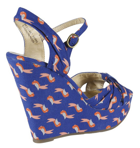 blue canvas wedges with red parrot-print design