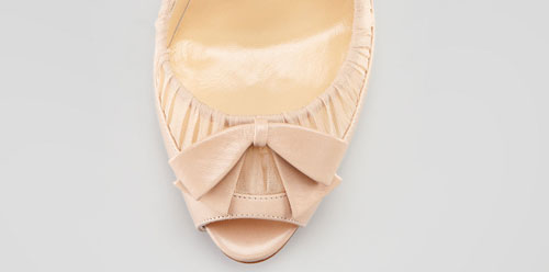 Pink leather bow on vamp of Christian Louboutin peep toe shoe