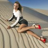 model in red and white t-bar sandals on the sand
