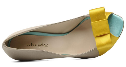 yellow bow on toe of taupe shoe