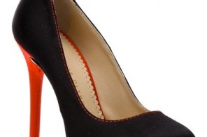 black platform shoes with red heel and heart detail