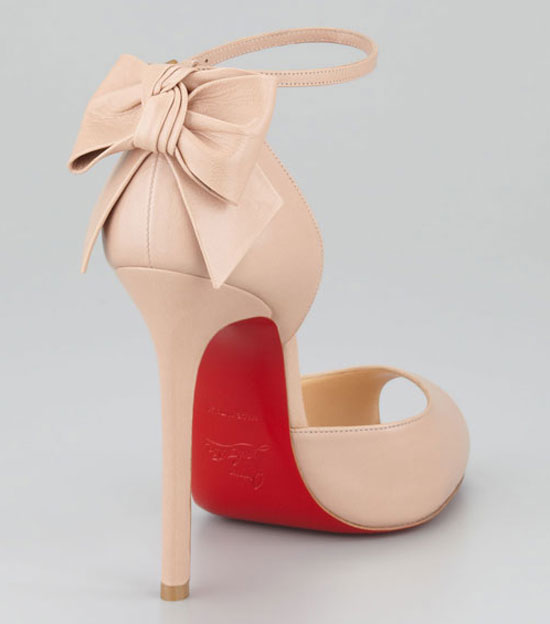 Back view of shoe showing red sole and bow on heel