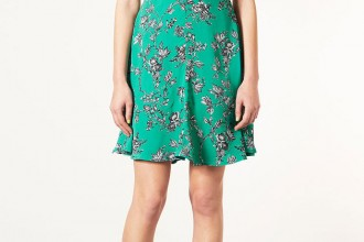 Model in green tea dress and red shoes