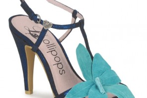 blue sandals with large flower embellishment
