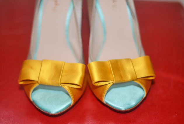 shoes with yellow bows on the toes