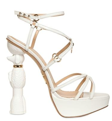white sandals with poodle-shaped heel