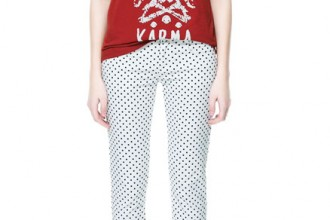 white polka dot pants with red sort and black shoes