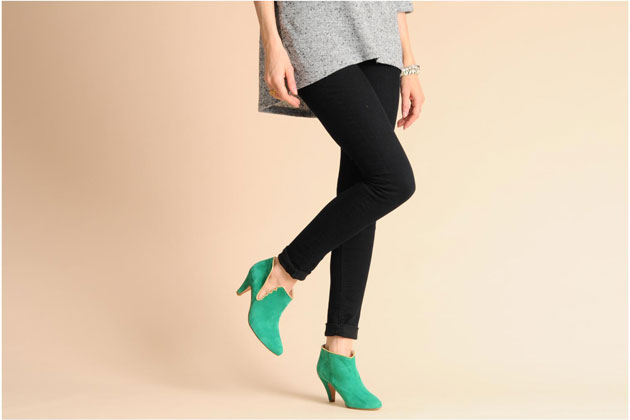 model in green suede ankle boots