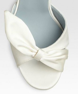 Christian Louboutin white bow shoe