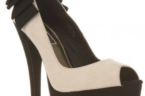 cream and black shoes with bow on heel