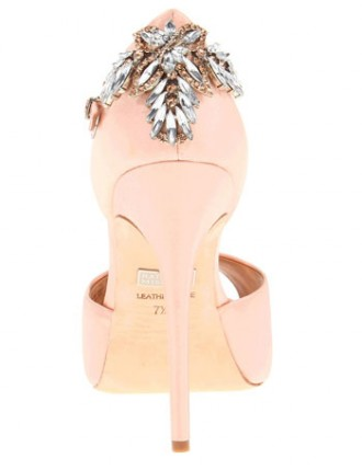 pink shoes with brooch on heel