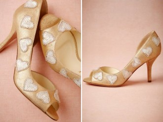 gold shoes with heart detail