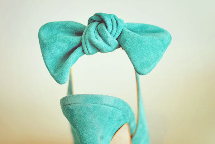 green bow on heel of slingback shoes