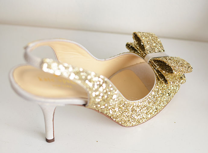 gold bow on front of shoe