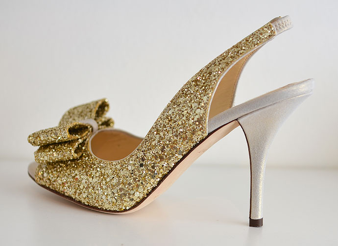 high heeled slingback shoe with gold glitter bow