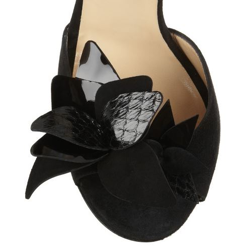 black flower on Ji,,u Choo sandals