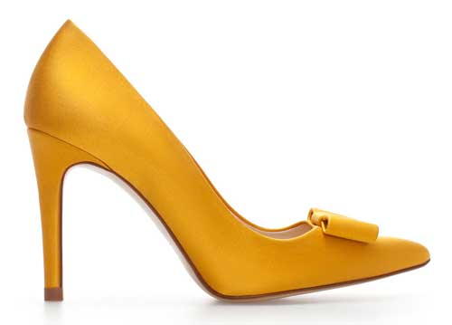 yellow high heeled court shoe with bow at toe