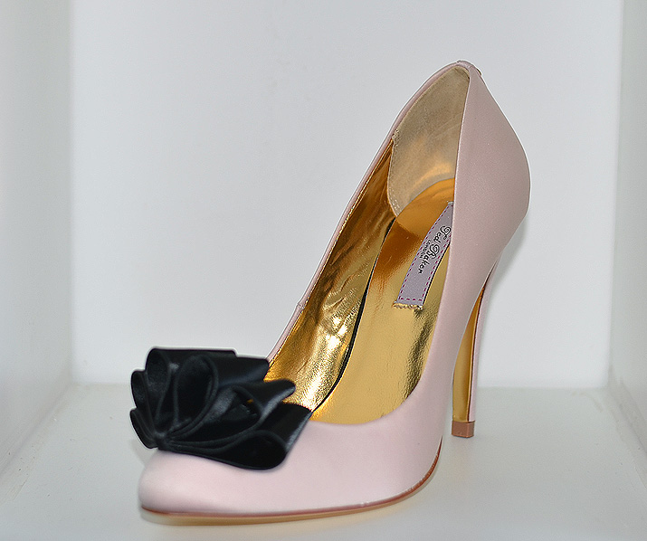 pink shoes with black bows