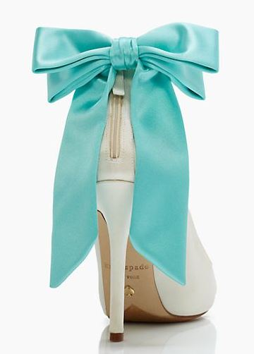 white shoes with blue bow on the heel