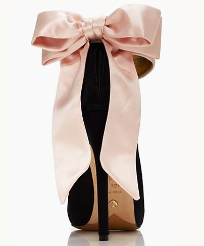 black shoes with pink bow on the heel