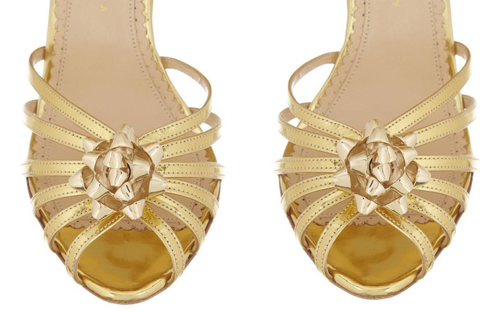 gold sandals with bows on shoes