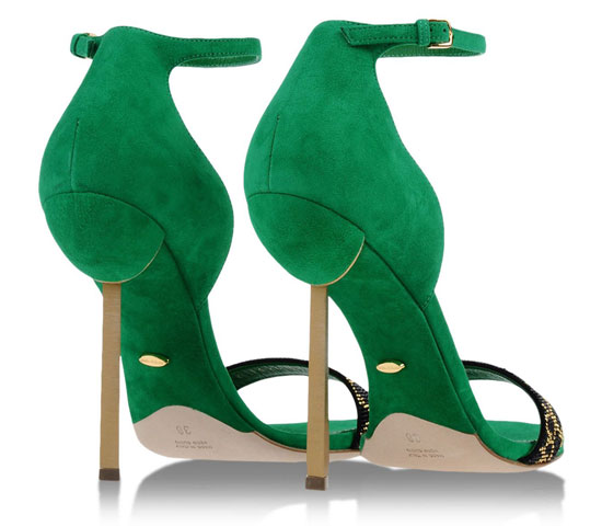 gold high heels on green shoe