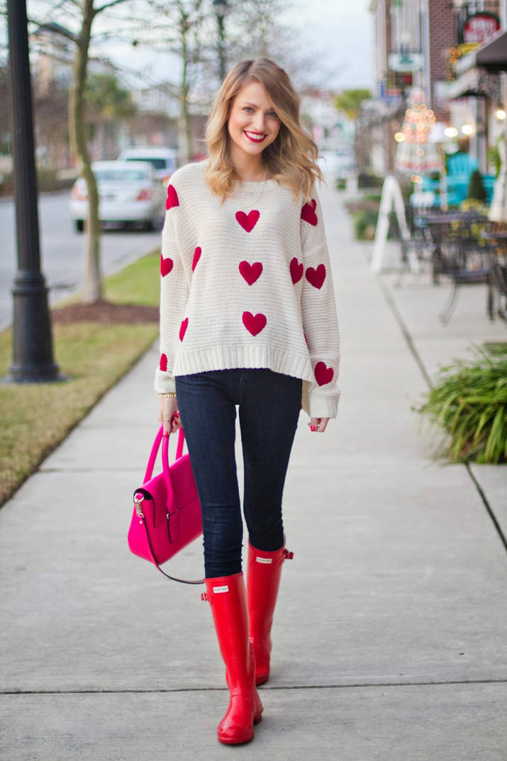 heart-print sweater and red Hunter boots