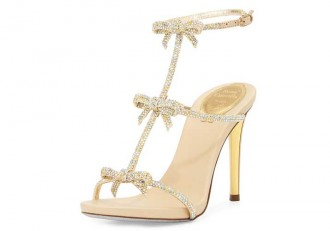 Gold heeled sandals with bows by Rene Caovilla