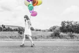 woman with colourful balloons