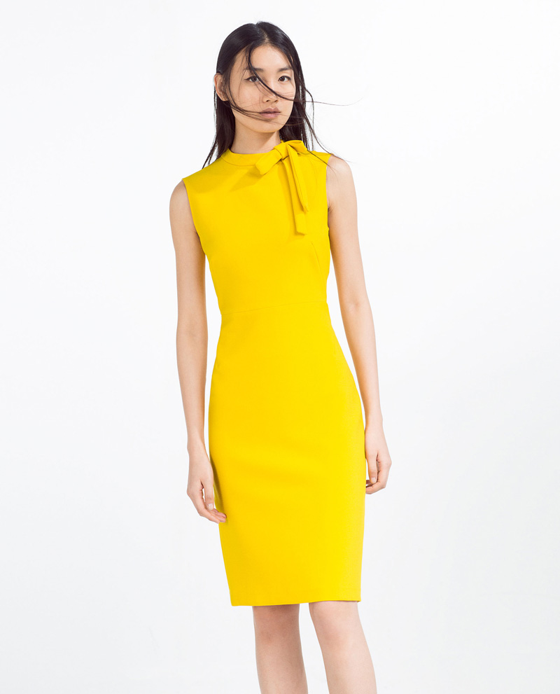 yellow dress with bow at neck