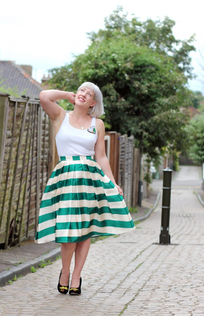 green stripe midi skirt with white top and heels
