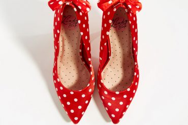 red polka dot shoes with bows on the heel