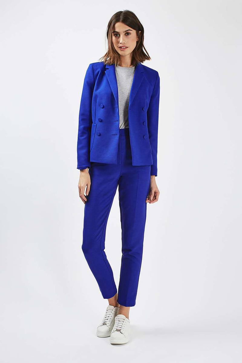 bright blue suit with white sneakers