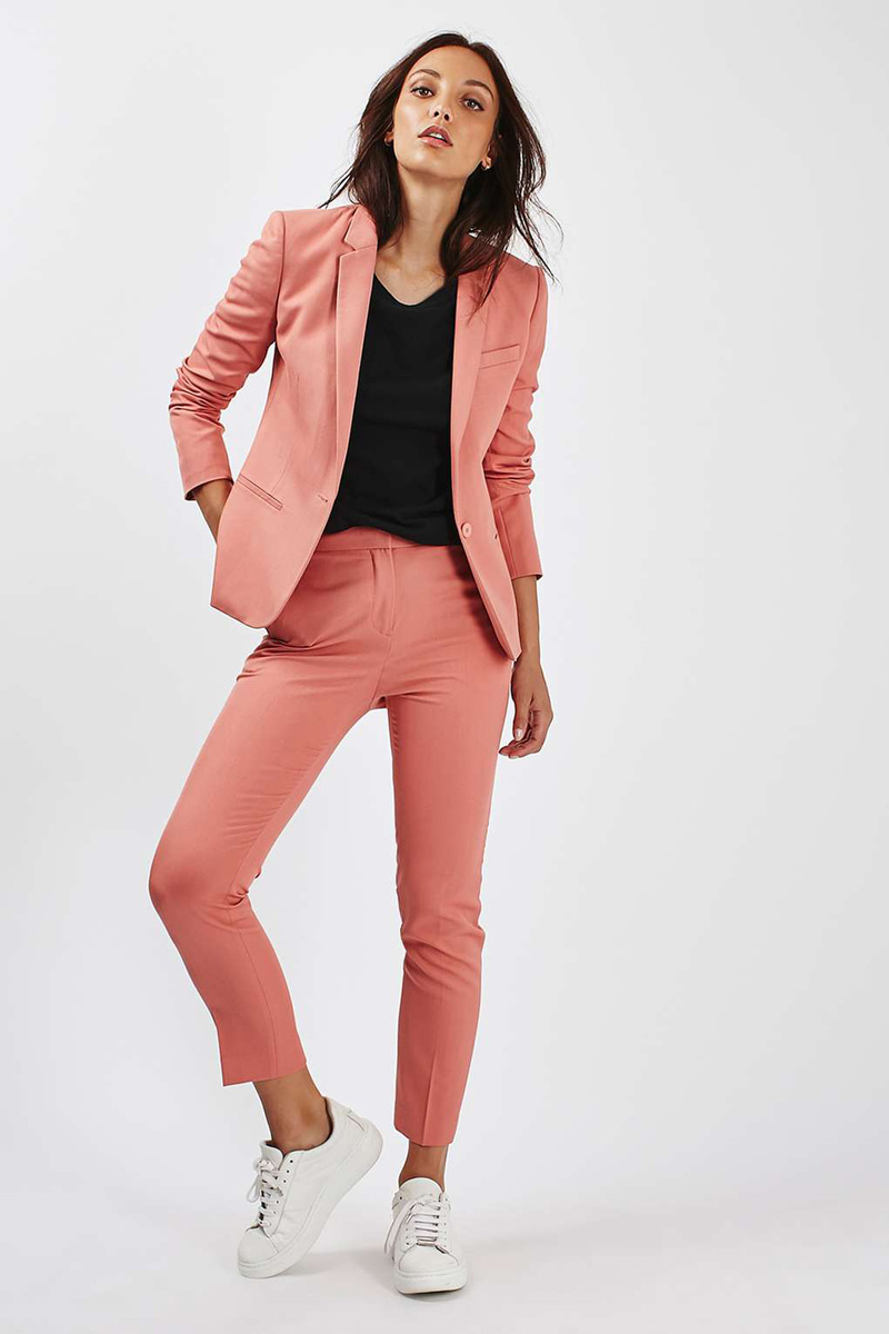 coral suit with white sneakers