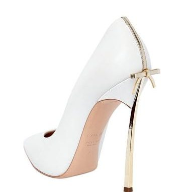 white Casadei Blade pumps with gold bow on the heel