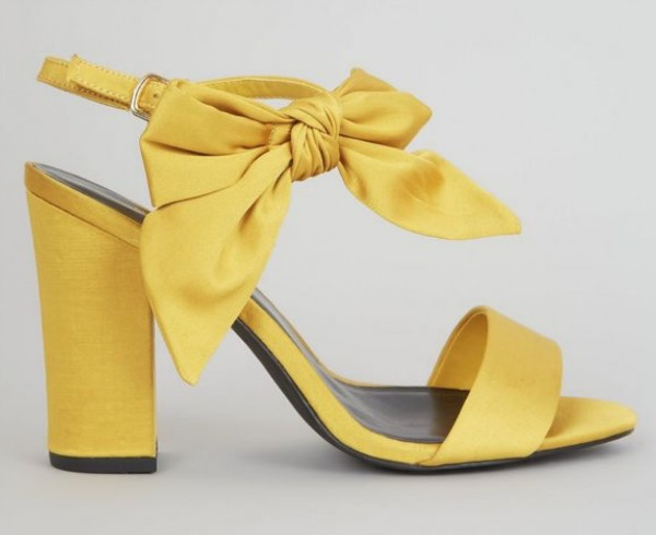 Yellow satin bow-sided heels