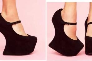 Black platform wedge shoes by Jeffrey Campbell